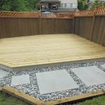 Large, ground level deck with pavers in a path, all ready for furniture and fun